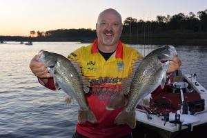 Patrick Conduit with a couple of big bass from the deeper flats of Boondooma using Tail Spinners