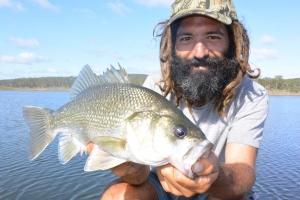 Ben Faro with a cracker of a bass caught on a deep flat